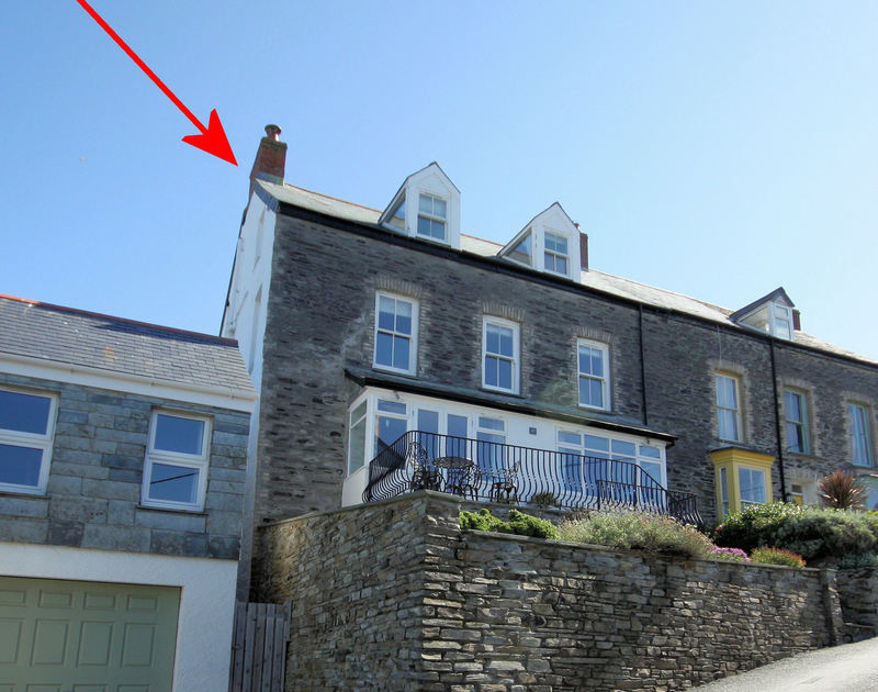 The exterior of attractive stone fronted Upper Deck,a self catering holiday duplex apartment in Port Isaac, North Cornwall.