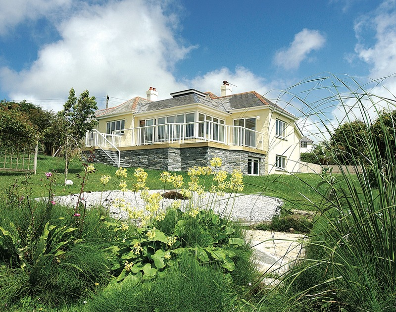 The exterior view of Thyme Bank, a self-catering holiday house at Daymer Bay, North Cornwall, with its attractive garden.